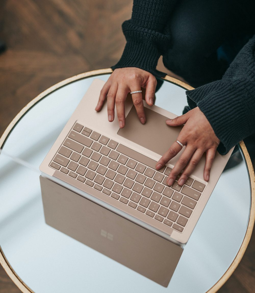 surface-linkedin-update-woman-hands-laptop-microsoft
