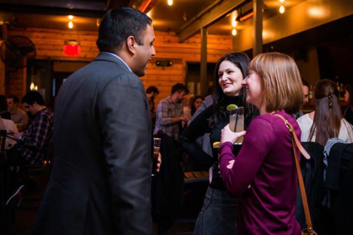 CS_Qlikd-diverse-group-talking-bar-drink-smiing