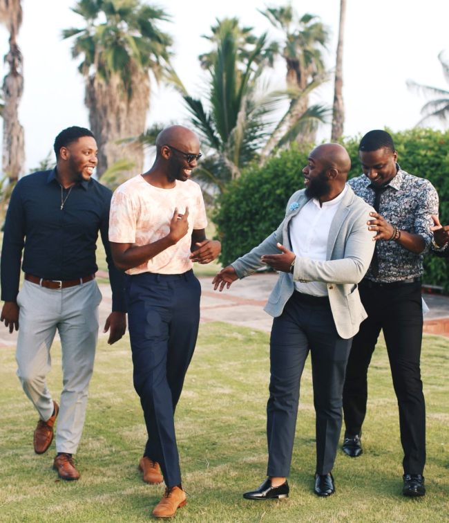 community-enjoying-facial-expression-black-men-walking-talking-cbcf-ALC-schedule-dinners-parties-receptions-2018-congressional-black-caucus-annual-legislative-conference