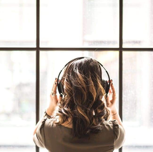 looking-out-window-wearing-headphones-best-podcast-washington-dc