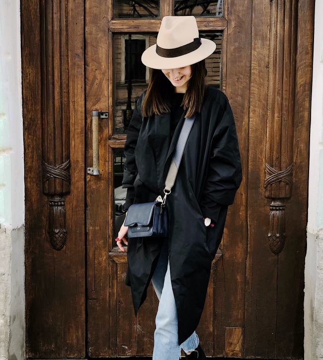 money-personal-mantra-definition-Woman-Wearing-Black-Coat-and-Faded-Blue-Jeans