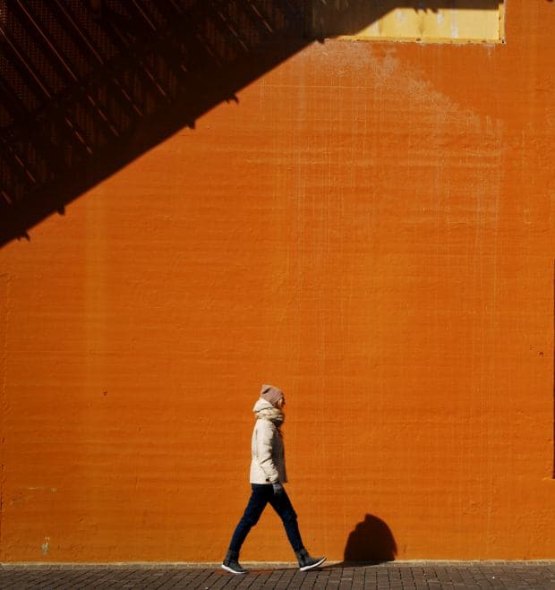 where-to-cry-in-dc-woman-walking-orange-wall-mary-deraedt