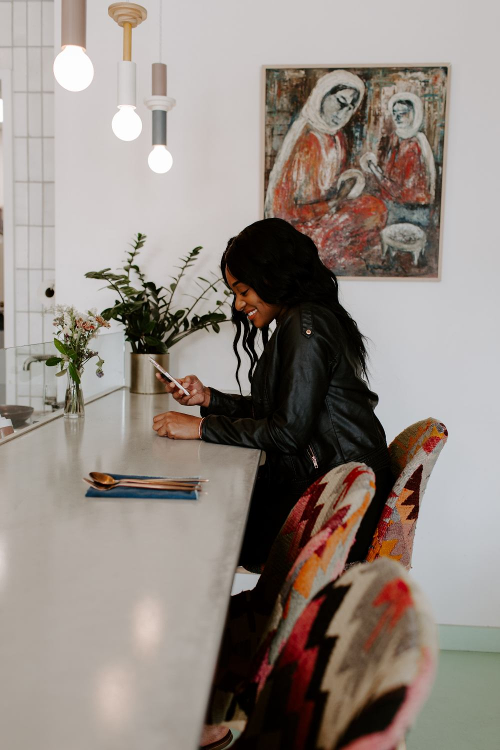 black-woman-smiling-sitting-using-phone-personal-career-brand